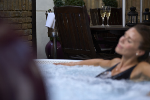 Woman enjoying the outdoor jacuzzi at Sir Christopher Wren Hotel, Windsor